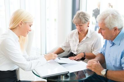 Elderly couple purchasing life insurance